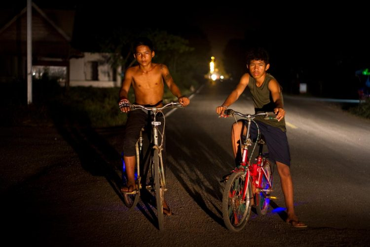 Two-boys-enjoy-their-night-bike-riding